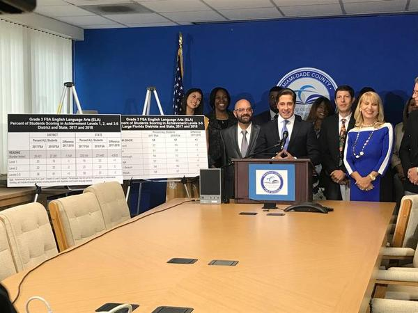 Miami-Dade County Public Schools Superintendent Alberto Carvalho, at the podium, announces the third grade results on the Florida Standards Assessments English Language Arts exam at the School Board Administration Building on May 25, 2018.