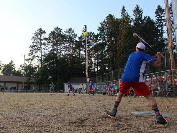 Huge crowds turn up each week to watch a game of baseball on a woodchip field, where the players wear snowshoes.
