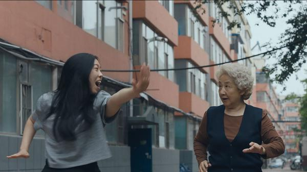 In <em>The Farewell</em>, Billi (Awkwafina, left) returns to China to spend time with her grandmother — who doesn't know she is dying thanks to an elaborate ruse.