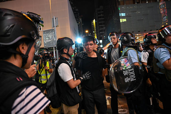 A protester is arrested during a stand-off with the police in the Mong Kok district after a demonstration at West Kowloon railway station protesting against the proposed extradition bill on July 7, 2019, in Hong Kong, China.
