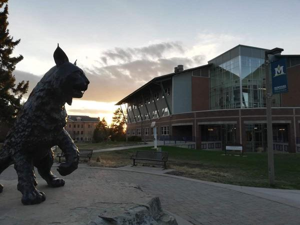 The sun sets behind Montana State University's sculpture of Spirit, the school's mascot, April 2019.