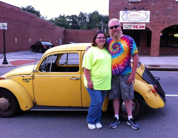 "Jessica Bray and her husband, Anthony Bray, pose with their 1970 Volkswagen Beetle. Anthony converted his Beetle to an electric car. ""As a special touch, we added bubble machines to the back to blow bubbles at car shows and as we drive,"" Jessica said."