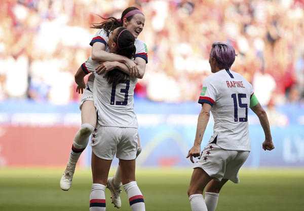 Lavelle, top, celebrates with teammates Alex Morgan and Megan Rapinoe after scoring her side's second goal during the Women's World Cup in Decines, France, on Sunday, July 7.