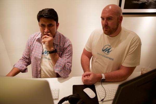<p>Sourabh Kothari (Left) and Drew Brazier (Right) work on their new app. It launched in June and has had several thousand downloads so far. </p>