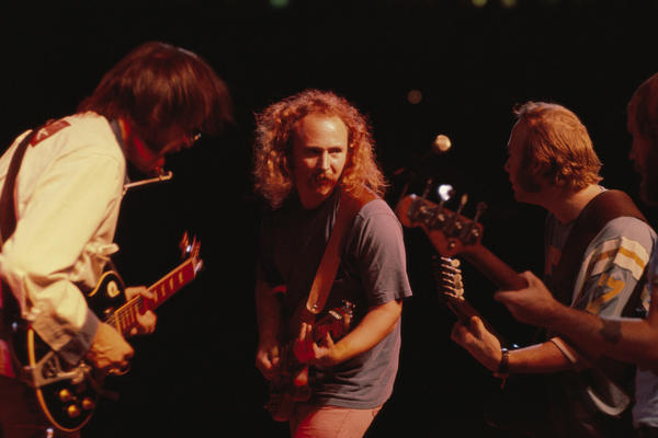 David Crosby (center) with Neil Young (l) and Stephen Stills (r) during a Crosby, Stills, Nash & Young concert in Texas in 1974.