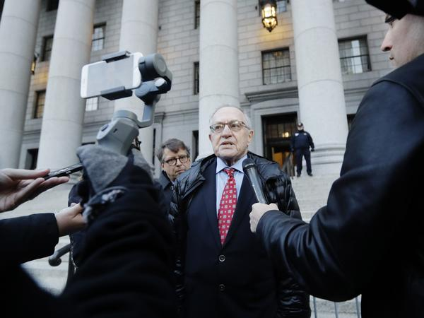 In March 2019, Attorney Alan Dershowitz speaks with reporters outside of Manhattan Federal Court after Virginia Giuffre filed a defamation lawsuit that includes allegations against him.