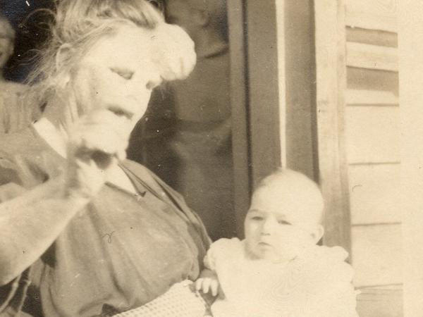 """The only surviving photo of Vivian Buck, here with her adoptive mother in 1924. This is the moment Vivian is determined by a eugenics researcher to be """"feeble-minded"""" for not looking at a coin held in front of her face."""