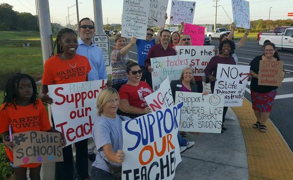 Parents and teachers protest allocation of public school funding outside of Florida Education Meeting