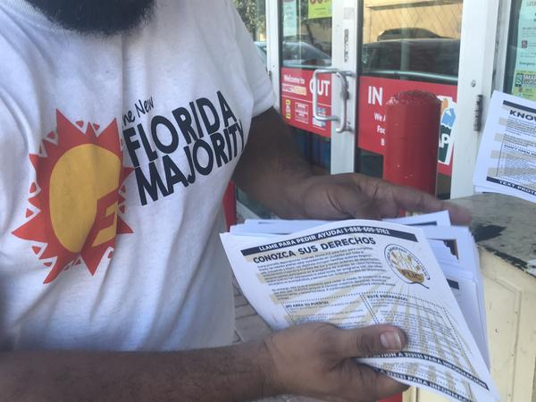 Volunteers from The New Florida Majority passed out more than 500 flyers at supermarkets in Hollywood on Tuesday, in English, Spanish, and Creole.