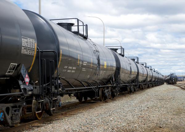 A train hauls tanker cars full of oil.