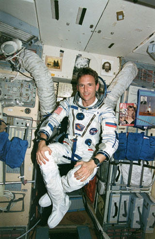 Jerry Linenger in his Sokol suit, floating in Mir Base Block.