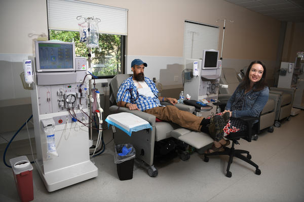 Sovereign Valentine and his wife, Jessica, wait as a dialysis machine filters his blood. Before finding a dialysis clinic in their insurance network, the Valentines were charged more than a half-million dollars for 14 weeks of treatment.