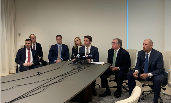 From right, attorney Steven Hart and others representing people allegedly victimized by Willowbrook company Sterigenics address the media on July 18