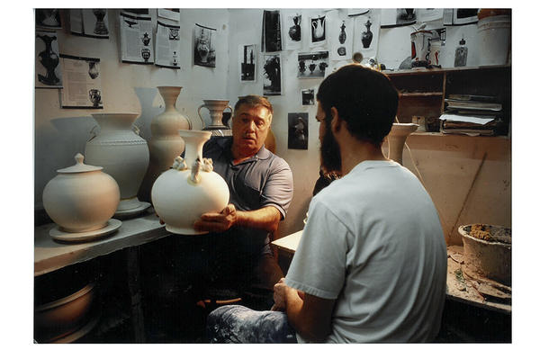 Victor Babu discusses a student's work during a critique session in the ceramics department at the Kansas City Art Institute.