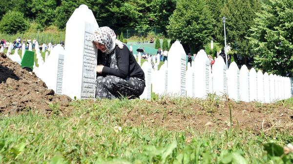 """The Dutch State bears very limited liability in the 'Mothers of Srebenica' case,"" the Supreme Court said Friday. Earlier this month, Bosnian Muslims visited the graves of their relatives at the memorial cemetery of the Srebrenica 1995 massacre in Potocari, near Srebrenica."