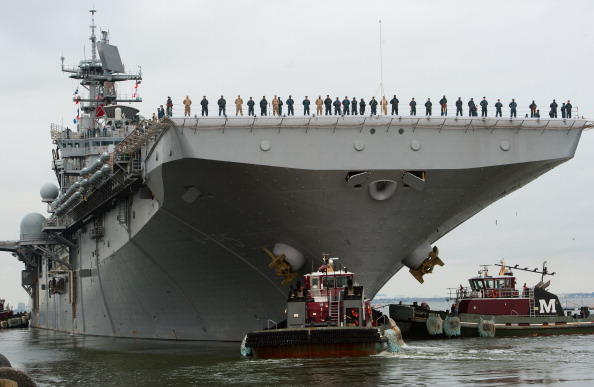 U.S. sailors man the rails as the USS Bataan, the lead ship in the Bataan Amphibious Ready Group, pulls out of the Norfolk, Virginia, U.S. Naval Base in May 2011, en route to waters off Libya.