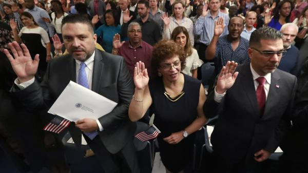New citizens take the oath of allegiance during a naturalization ceremony in Oakland Park, Fla., earlier this year. The Trump administration has announced there will be changes to the U.S. citizenship test.