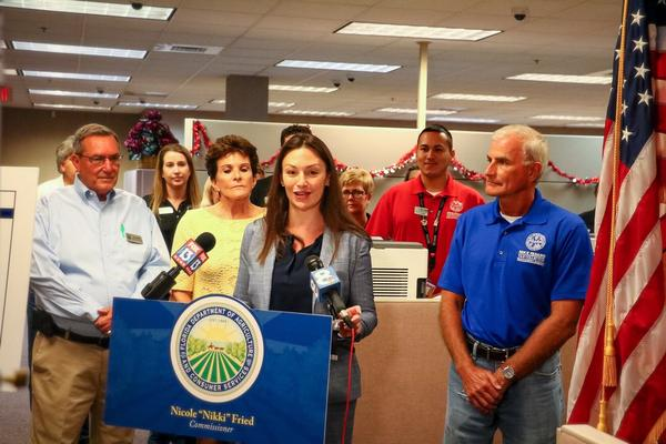 Agriculture Commissioner Nikki Fried, center, said at the Pasco County Tax Collector's Office in Dade City that review times for applications for concealed-weapons licenses have been reduced.