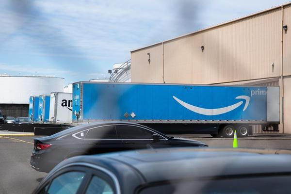 <p>Trucks sit at the loading docks of the Amazon delivery station in northwest Portland, Ore., Friday, July 12, 2019.</p>