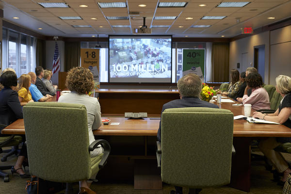 Kroger and EPA officials watch a video presentation before discussion.