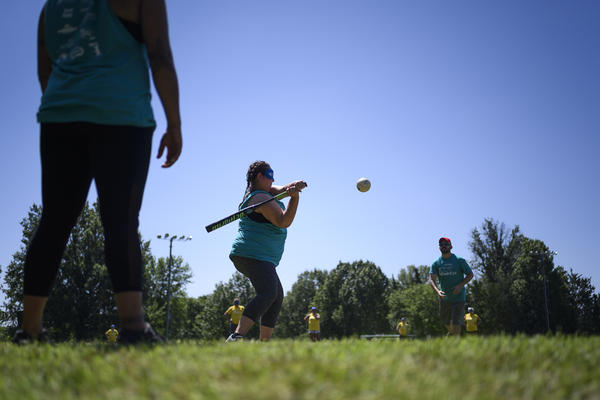 A batter swings at a softball equipped with an electronic beeper at the Ultimate Beepball Championship Tournament.