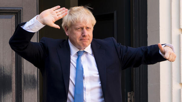 Boris Johnson, who has been elected the U.K.'s incoming prime minister, arrives at the Conservative Party's headquarters in central London on Tuesday.