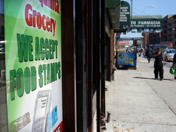 A grocery store in New York City advertises that it accepts food stamps. A Trump administration proposal could result in 3 million people losing their food assistance.