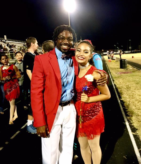 Haley Derigo and Dr. Graham smile together at a King High School event.
