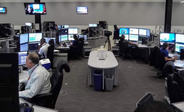 The control center has six pods with operators, and room to add more as the network grows.