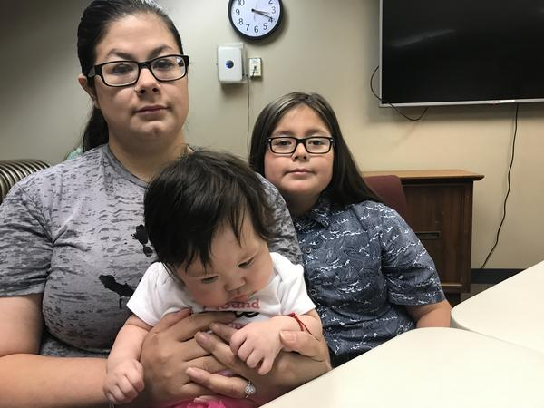 Cheyenne Hoyt, her 7-month-old daughter and 11-year-old son. Hoyt says the father of the children called her from Mexico on Wednesday night to say he'd been deported.