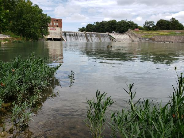 The floodgate is to the left of the dam on Lake McQueeney.