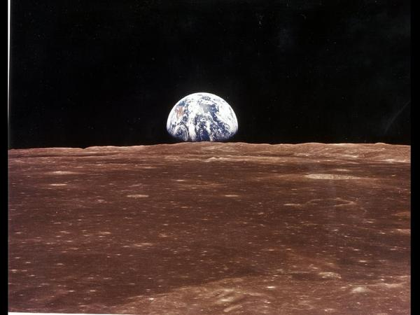 A view of Earth as the Apollo 11 command module came into view of the moon before astronauts Neil Armstrong and Edwin Aldrin Jr. left in the lunar module, Eagle, to become the first men to walk on the moon's surface.