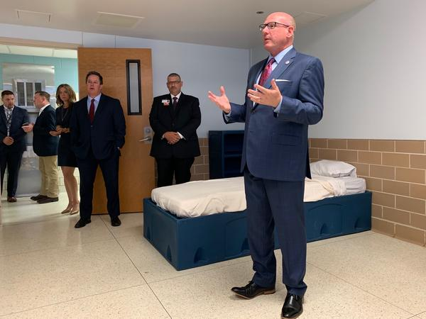 Tim Bray with the Texas Health and Human Services Commission explains the features of a patient room in the new veterans unit at Terrell State Hospital.
