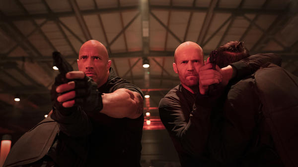 """Bald-faced fury: Dwayne """"The Rock"""" Johnson and Jason Statham team up as Luke Hobbs and Deckard Shaw in this <em>Fast & Furious </em>spinoff directed by David Leitch."""