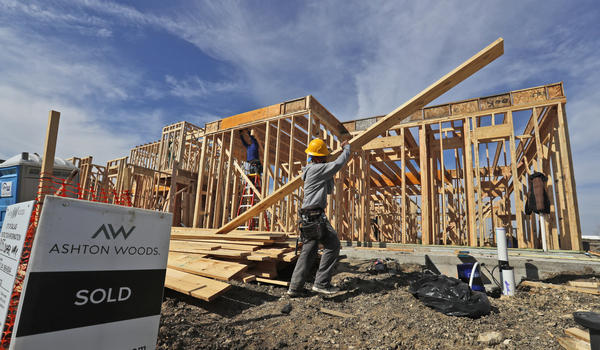 A construction crew works on an already sold new home in North Dallas