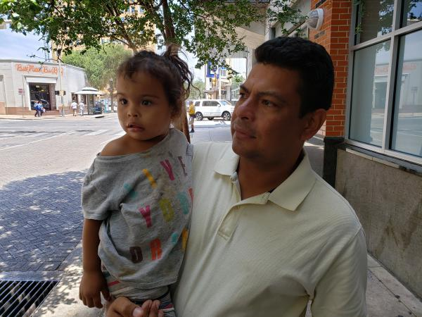 Donaldo Maradiaga and his daughter Nayely outside the city's migrant resource center.