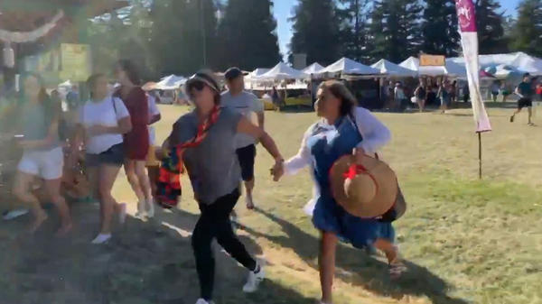 People run for safety after a gunman opened fire at the Gilroy Garlic Festival, south of San Jose, Calif., on Sunday.