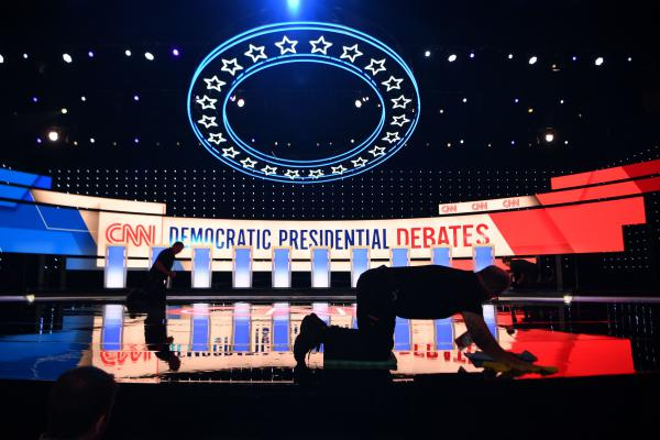 Workers prepare the debate stage at the Fox Theatre in Detroit ahead of Tuesday's Democratic presidential debate.
