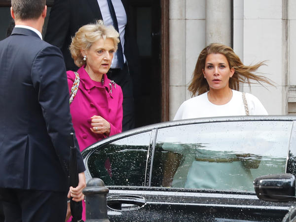 Princess Haya bint al-Hussein of Jordan (right), accompanied by her lawyer lawyer Fiona Shackleton (center), leaves the High Court in London on Tuesday.