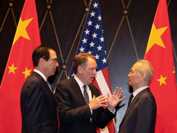 U.S. Treasury Secretary Steven Mnuchin (left) looks on as U.S. Trade Representative Robert Lighthizer speaks with and Chinese Vice Premier Liu He in Shanghai on Wednesday.