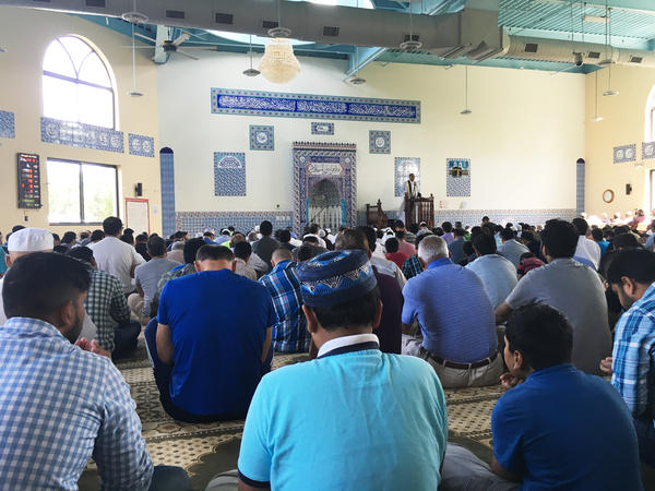 Men attend Friday prayers at a mosque in Edison, N.J.
