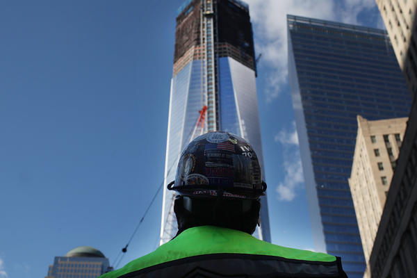A construction worker looks up at One World Trade Center in New York City, the central skyscraper under construction at Ground Zero, a year before its 2013 completion.