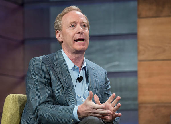 Brad Smith speaks at the Microsoft Annual Shareholders meeting in 2015. The Microsoft president issued sharp words Tuesday against President Trump's decision to cancel DACA in six months and called on Congress to make immigration a top priority.