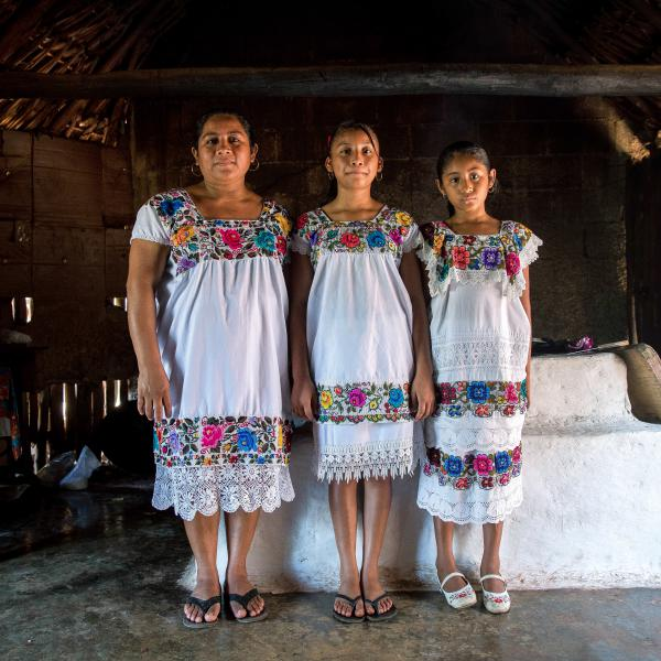 Maria de los Angeles Tun Burgos with daughters Angela, 12, and Gelmy, 9, in their family home in a Maya village in Yucatán, Mexico.