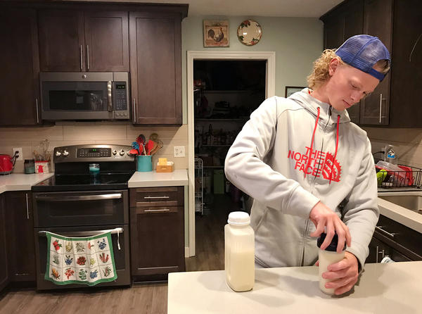 Jonah Reeder prepares a special protein shake that helps him manage a metabolic condition called phenylketonuria.
