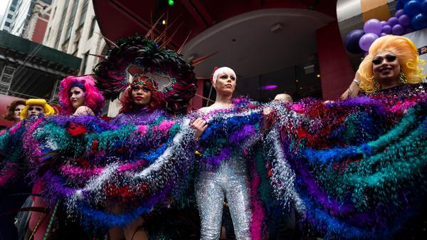 Drag queens hold a feather boa in an attempt to break the Guinness World Records title for the longest feather boa during a celebration of Pride Month in New York City's Times Square on June 20.