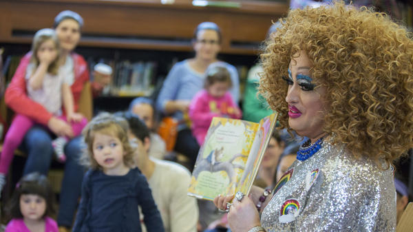 Lil Miss Hot Mess reads to children during a Drag Queen Story Hour in Brooklyn, N.Y. The event is held in libraries across the country, including, in the past, at the Carnegie Library of Pittsburgh.