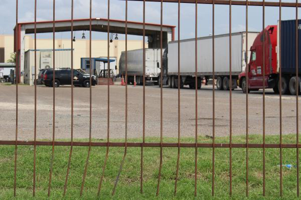 Trucks line up to pass through a checkpoint at the U.S./Mexico border in Pharr, Tex. Truckers say the immigration crackdown has led to waitimes as long as six hours to cross the border.