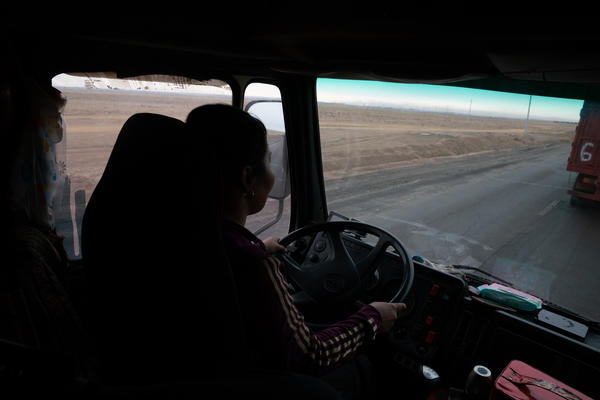 Gulnara Dariiga, 38, drives a truck piled high with coal as she waits to cross the border.  A mining boom in the Gobi Desert is fueling cross-border trade between Mongolia and China, with millions of tons of coal, copper and precious minerals moving by the truckload every year.