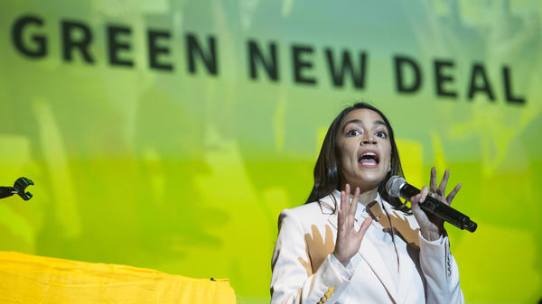 "Rep. Alexandria Ocasio-Cortez speaks about the Green New Deal in Washington, D.C., on May 13. She has shined a spotlight on a once-obscure brand of economics known as ""modern monetary theory."""